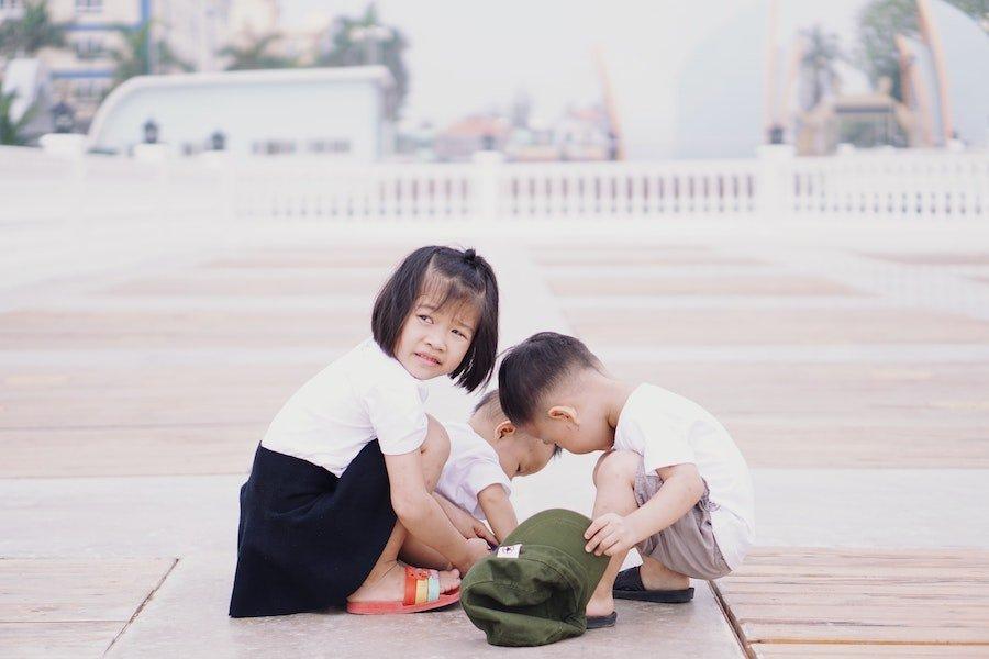 Three children playing - Petite Dreamers