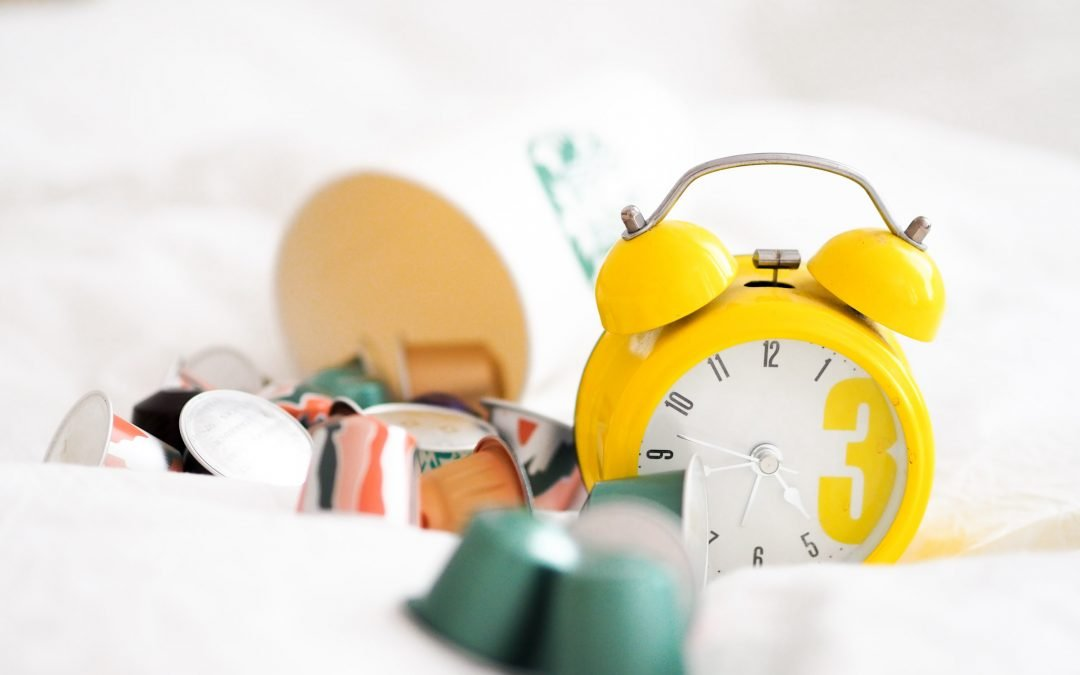 clock and coffee pods - Petite Dreamers